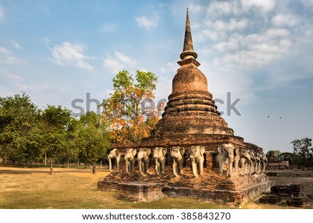 Sorasak temple in Sukhothai, Thailand, was probably built early in the fifteenth century, and is notable for the elephants that line the base of the chedi.