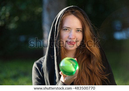 Sorceress with red hair with green magic ball