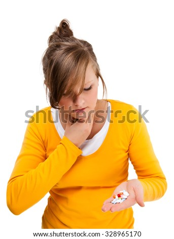Sore throat - woman holding pills isolated on white background  - stock photo