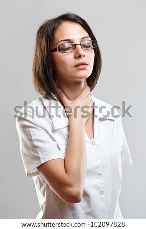 Sore throat young woman in gray background - stock photo