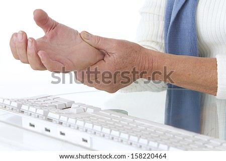 sore wrist - occupational disease - stock photo