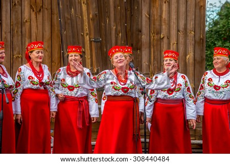 SOROCHYNTSI, UKRAINE - 21 AUGUST 2015: The fair is a large showcase for traditional handicrafts made by skilled craftsmen, including embroidery, rugs, ceramics, as well theatrical performers.  - stock photo