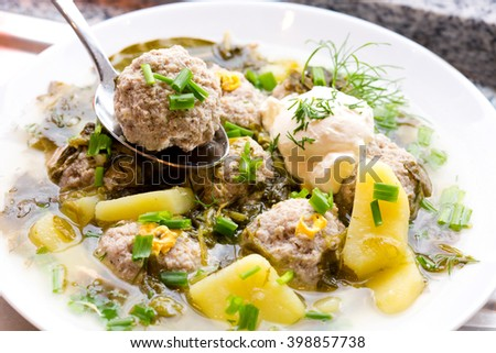 Sorrel soup with meatballs  - stock photo