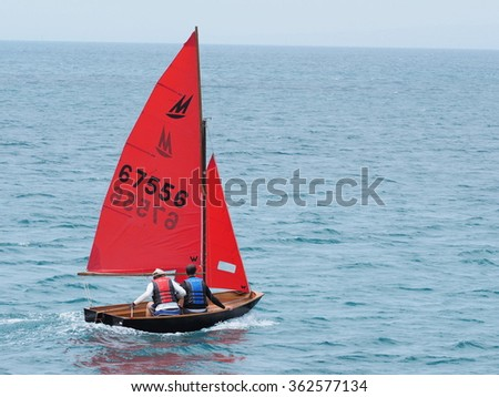 Sorrento, Australia, 2016, January 1: Sailboat with red sail on the ocean bay