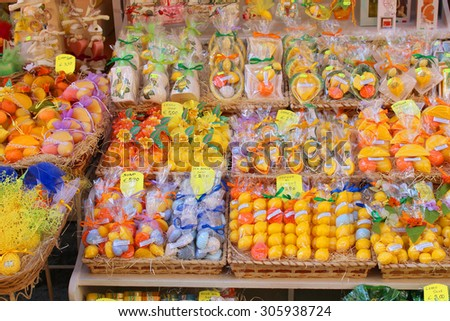 SORRENTO, ITALY - JUNE 26, 2015: A colorful display outside a store in Sorrento,  selling different citrus soaps and souvenirs made from lemons and other fruits famous in Southern Italy - stock photo