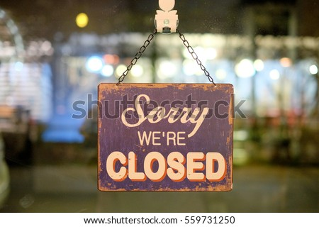 Sorry sign hang on mirror of shop