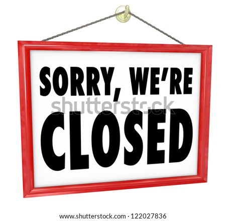 Sorry We're Closed sign hanging in a store window to represent closure, bankruptcy, after hours or going out of business
