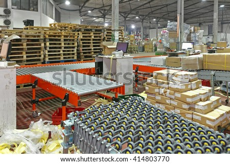 Sorting Cargo and Delivery Distribution Warehouse - stock photo