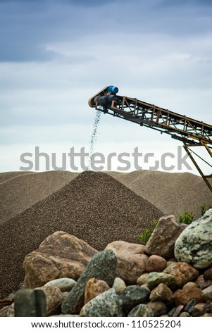 Sorting sand at gravel pit - stock photo