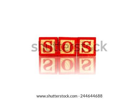 sos word reflection on white background - stock photo