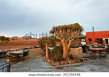 SOSSUSVLEI, NAMIBIA - JAN 30, 2016: Outdoor cafe on the terrace of the Sossusvlei Lodge, the most popular place in Namib Naukluft park to stay during safari