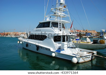 SOTOGRANDE, SPAIN - JULY 18, 2008 - Yachts and boats in the marina with buildings to the rear, Puerto Sotogrande, Malaga, Cadiz Province, Andalucia, Spain, Western Europe, July 18, 2008. - stock photo