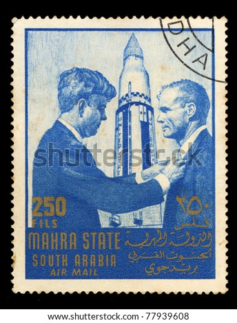 SOUDI ARABIA - CIRCA 1967: A stamp printed in Mahra State of Saudi Arabia shows two men, circa 1967 - stock photo