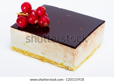 Souffle cake with red currant on a white background - stock photo