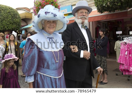 SOULAC SUR MER, FRANCE - JUNE 5: An elderly couple during the parade  at the Soulac 1900 festival on june 5,  2011 in Soulac sur mer, France. Every year all the resort relives his Belle Epoque 1900 .