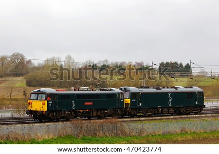 SOULBURY, UK - APRIL 7: Two electric locos from the Caledonian overnight sleeper service head down the WCML on April 7, 2016 in Soulbury. The Caledonian sleeper runs from Scotland to London Euston.