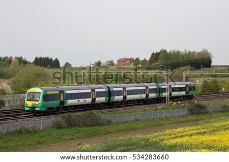SOULBURY, UK - MAY 9: A Southern Rail operated unit heads towards Wolverton works for refurbishment on May 9, 2016 in Soulbury. Southern call at 213 stations and operate a fleet of 297 units in the UK