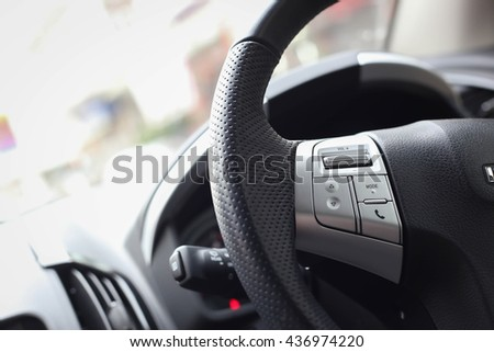 Sound audio music and phone function control button on the left hand side of car steering wheel
