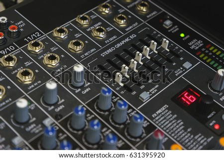 Sound equipment for a nightclub, discotheque or recording studio. The mixing console of the sound engineer in operation. Equalizer for concerts and events.