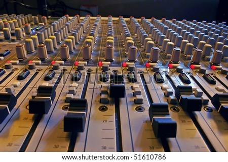 Sound mixer, closeup of the knobs. - stock photo