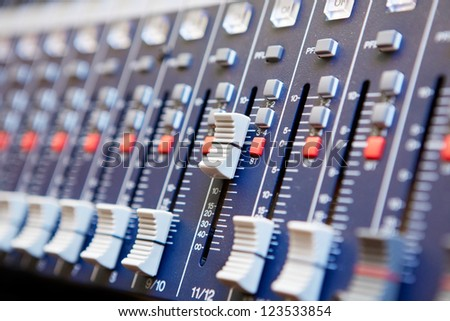 Sound mixer control panel, close-up - stock photo