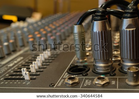 Sound mixer control with volume buttons. - stock photo