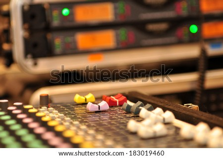 Sound mixer, low angle shot with shallow DOF, useful for various - stock photo