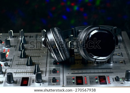sound mixer with headphones resting on the top - stock photo