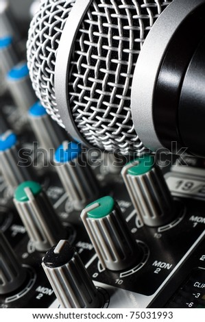 Sound mixer with microphone and blurs - stock photo