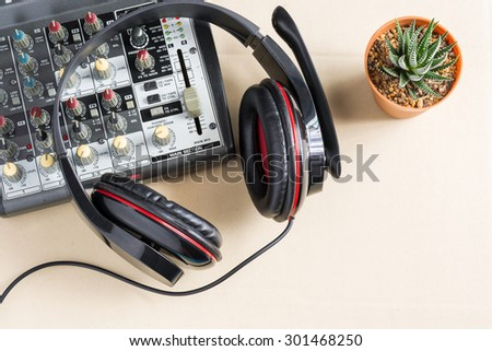 sound mixing console with old headphones and with haworthia fasciata(Willd.) - stock photo
