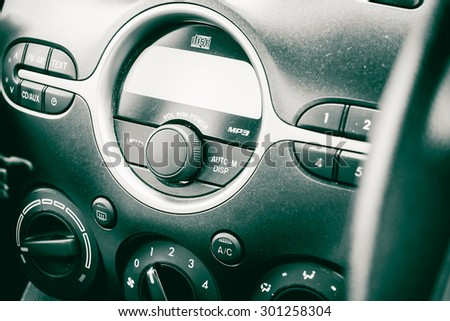 sound player in car close-up vintage tone style. - stock photo