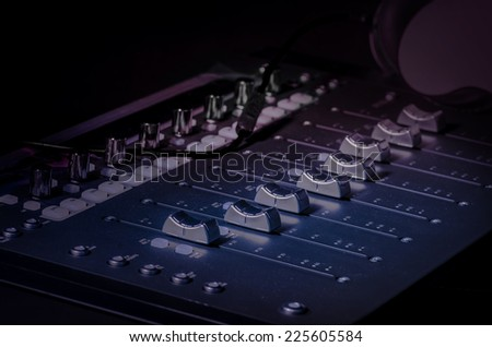Sound recording studio technology sliders knobs - stock photo