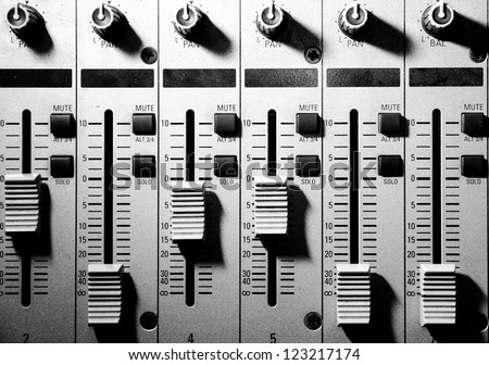 sound studio adjusting record equipment - stock photo