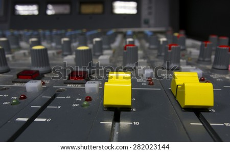 sound studio adjusting record equipment console sound engineer  - stock photo