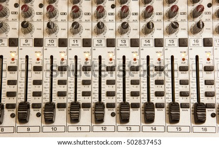 Sound studio record equipment with faders and adjusting knobs