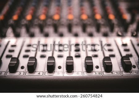 Sound studio recording equipment, music mixer controls at concert or party in a night club. Soft effect on photo  - stock photo