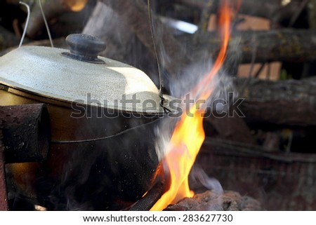 soup cooking in a pot on the fire