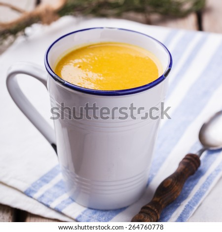 Soup-cream of corn with curry paste and rosemary, in a mug.selective focus - stock photo
