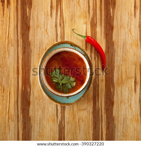soup dish on wooden table surface - stock photo