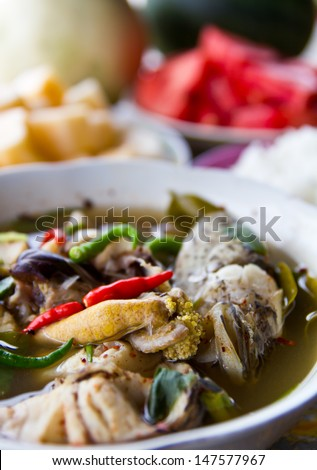 Soup fish with steamed rice and fruits, which are placed to eat.