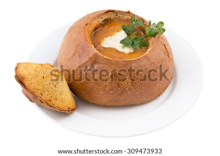 soup goulash with sausages in bread