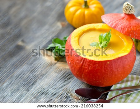 Soup in a pumpkin sample text - stock photo
