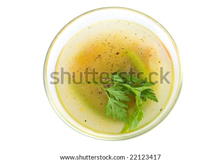 Soup in glass plate on white ground