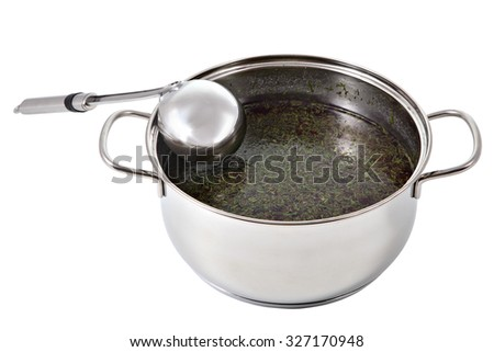 Soup ladle stainless steel lies in a pot of broth, isolated on white background. - stock photo