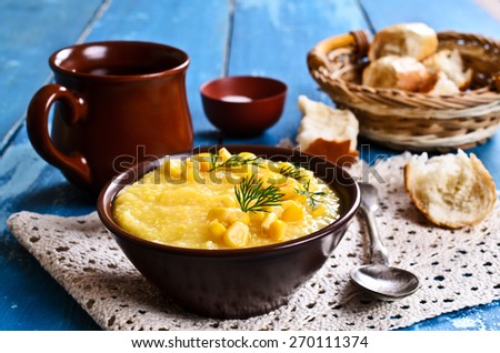 Soup made from ground beans corn yellow in the plate - stock photo