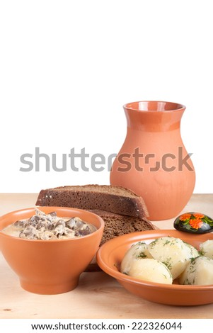 Soup of chicken liver and boiled potato with dill on a wooden board - stock photo