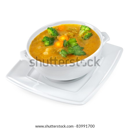 Soup of mashed potatoes with vegetables on a white background - stock photo