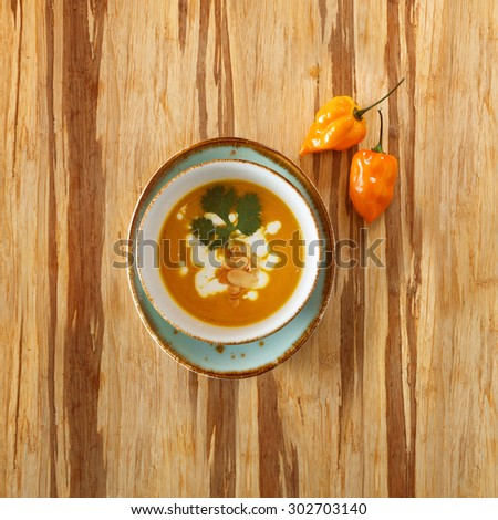 soup plate on wooden table surface - stock photo