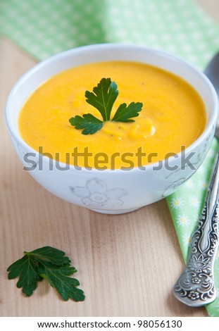 soup puree made of pumpkin in white bowl
