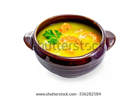 Soup-puree pumpkin with shrimps in a clay bowl with parsley isolated on white background - stock photo